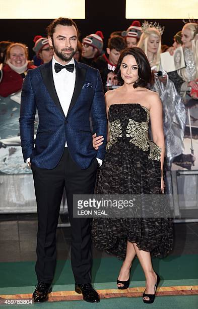 Irish actor Aidan Turner and his partner Sarah Greene pose for pictures on the red carpet upon arrival for the world premier of 'The Hobbit The...
