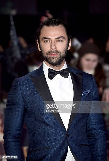 Irish actor Aidan Turner poses for pictures on the red carpet upon arrival for the world premier of 'The Hobbit The Battle of the Five Armies' in...