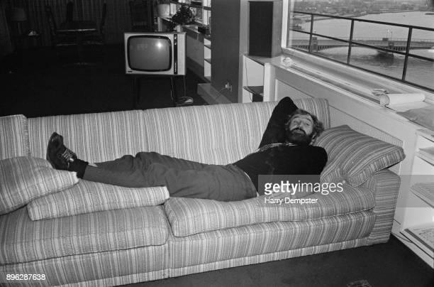 Irish actor and singer Richard Harris lying on a sofa UK 17th July 1971