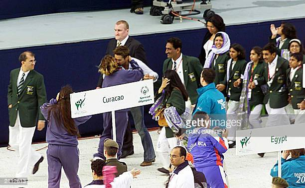 Irish Actor Colin Farrell walking with the Pakistan team is grabbed by a Costa Rica team member for a big kiss during the opening ceremonies of the...