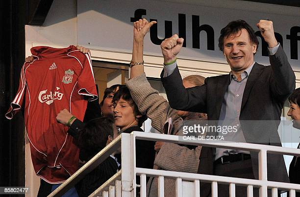 Irish Actor Liam Neeson celebrates Liverpool 10 win after their Premiership match against Fulham at home to Fulham at Craven Cottage football stadium...