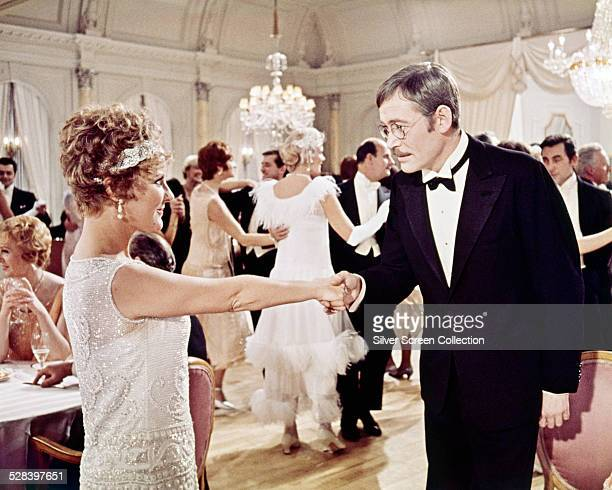 Irish actor Peter O'Toole as Arthur Chipping, and English singer and actress Petula Clark as Katherine Bridges, in a ballroom scene from 'Goodbye,...