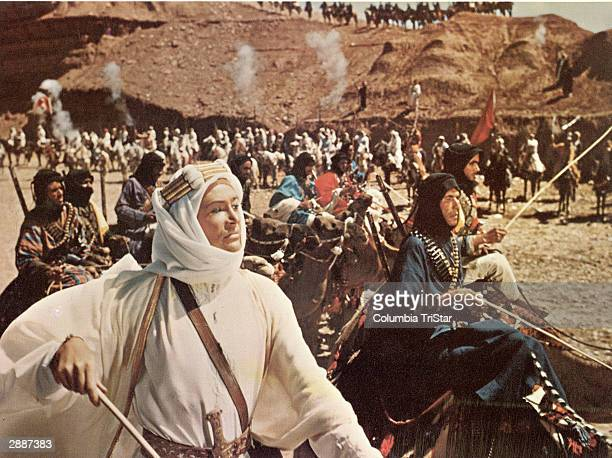 Irish actor Peter O'Toole leads a mounted army in the desert in a still from the film 'Lawrence Of Arabia' directed by David Lean 1962