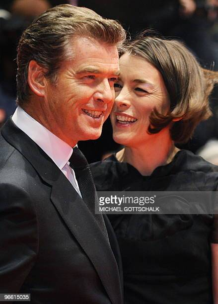 Irish actor Pierce Brosnan and British actress Olivia Williams arrive on the red carpet ahead of the premiere of the movie The Ghost Writer by Roman...