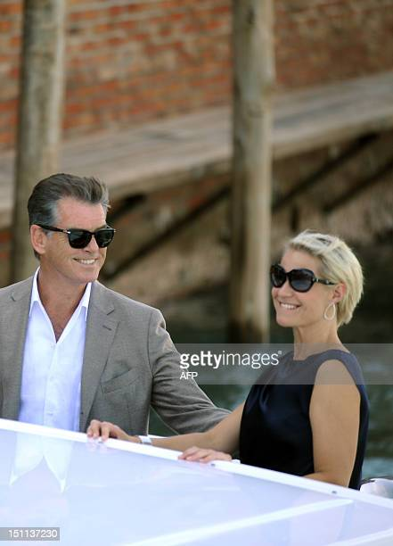 Irish actor Pierce Brosnan and Danish actress Tryne Dyrholm arrive in a boat at Venice Lido during the 69th Venice Film Festival on September 2 2012...