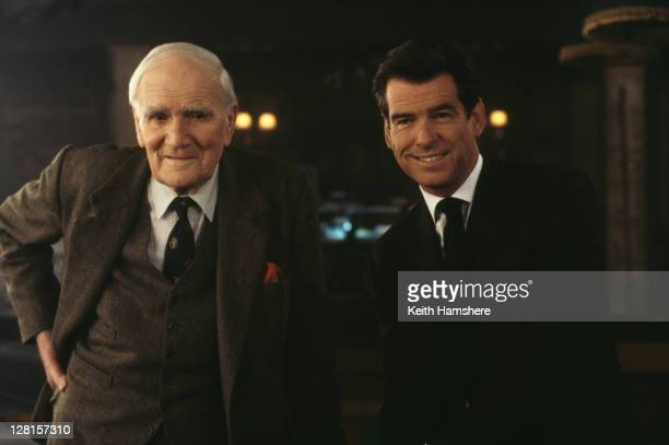 Irish actor Pierce Brosnan as 007 and Welsh actor Desmond Llewelyn as Q in a scene from the James Bond film 'The World Is Not Enough' 1999