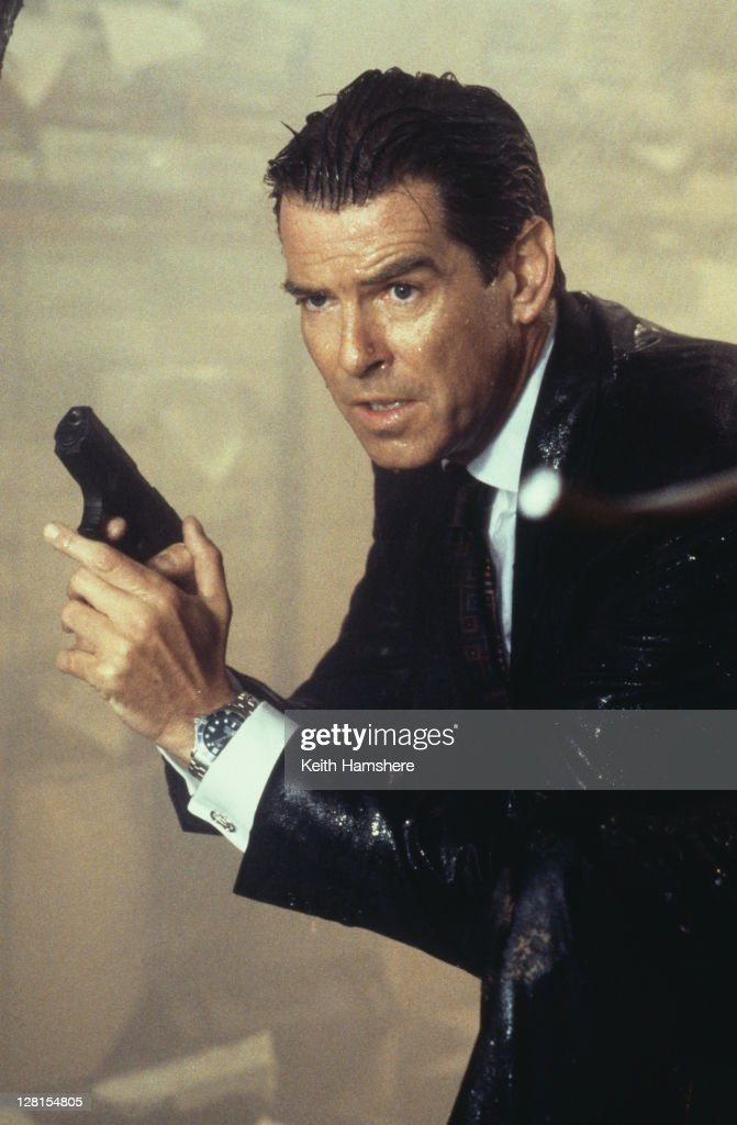 Irish actor Pierce Brosnan as 007, armed with his Walther P99, in a scene from the James Bond film 'The World Is Not Enough', 1999.