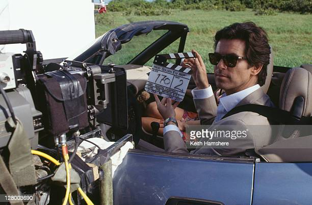 Irish actor Pierce Brosnan as 007 driving a BMW Z3 for a scene in the James Bond film 'GoldenEye' 2nd February 1995 Polish actress Izabella Scorupco...
