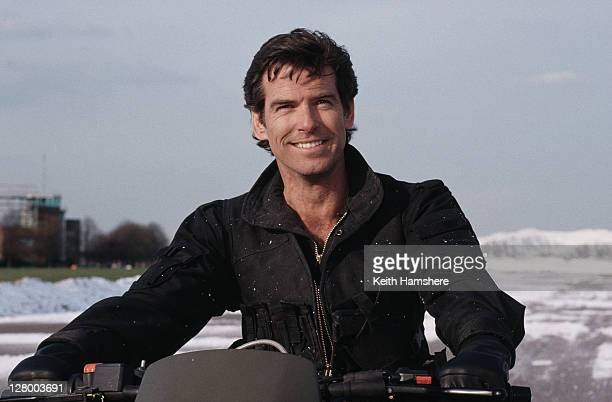 Irish actor Pierce Brosnan as 007 driving a Cagiva motorcycle for the opening scene of the James Bond film 'GoldenEye' 1995
