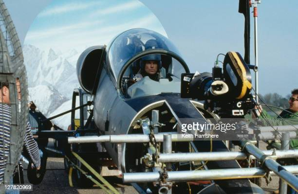 Irish actor Pierce Brosnan as 007 filming a scene in a fake L39 Albatros for the opening sequence of the James Bond film 'Tomorrow Never Dies' 1997...