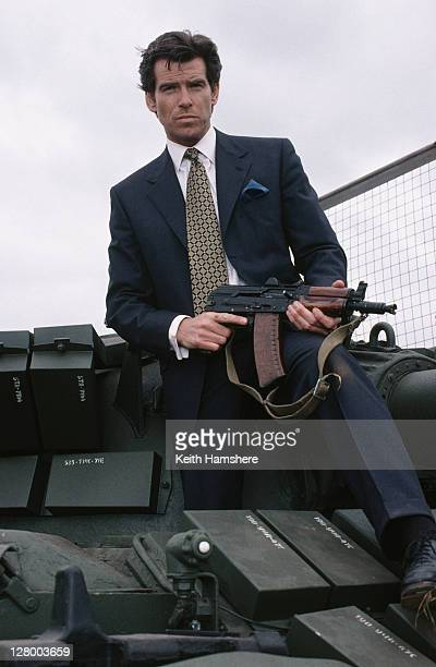 Irish actor Pierce Brosnan as 007 with a Russian T55 Main Battle Tank and a Kalashnikov AKS74U in a publicity still for the James Bond film...