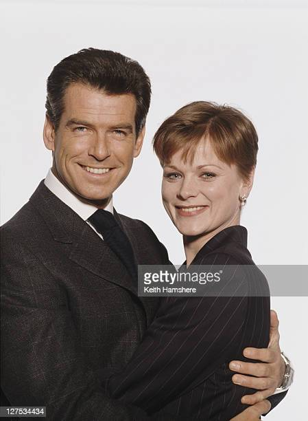 Irish actor Pierce Brosnan as 007 with actress Samantha Bond as Miss Moneypenny in a publicity still for the James Bond film 'The World Is Not...