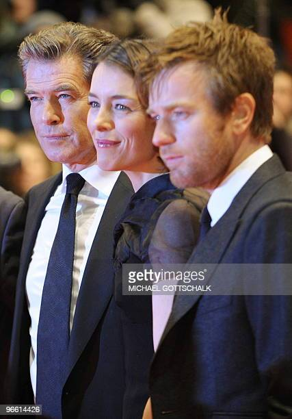 Irish actor Pierce Brosnan British actress Olivia Williams and British actor Ewan McGregor pose for photographers as they arrive on the red carpet...