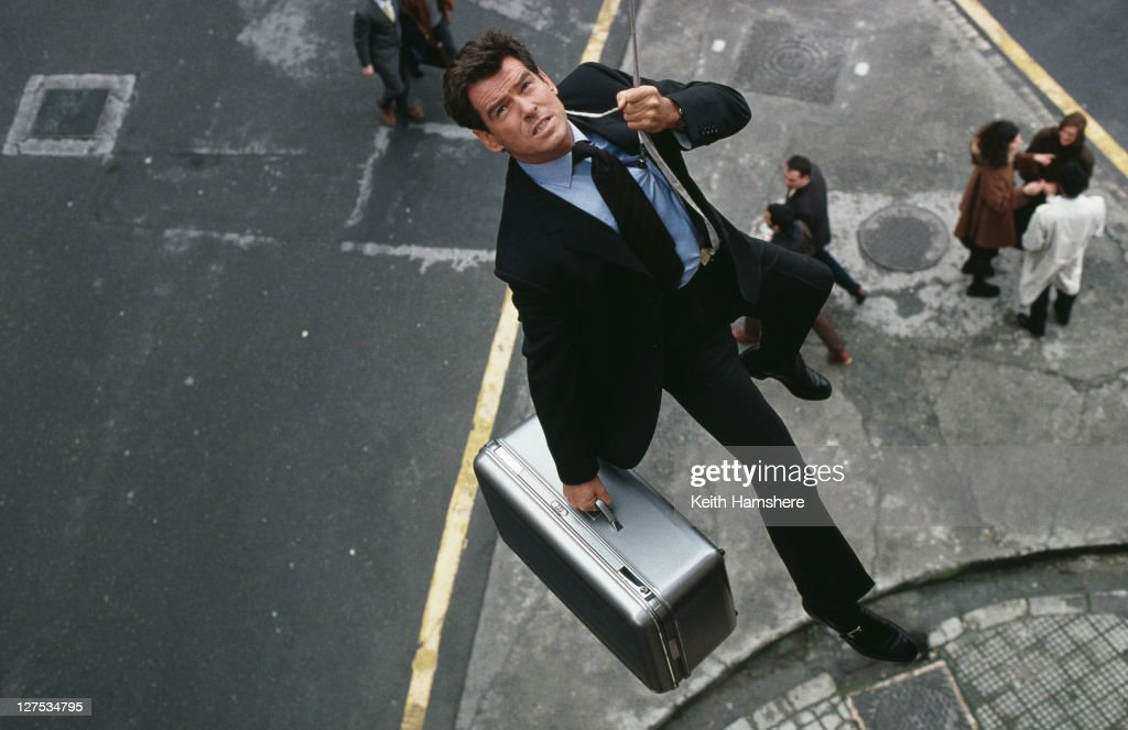 Irish actor Pierce Brosnan leaps from a banker's window carrying a briefcase in the opening scene of the James Bond film 'The World Is Not Enough', 1999. The scene was filmed in Bilbao, Spain.