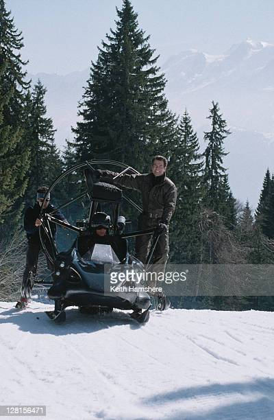 Irish actor Pierce Brosnan poses on a custombuilt jetpropelled Flying Parahawk/Polaris Snowmobile during the filming of the James Bond film 'The...