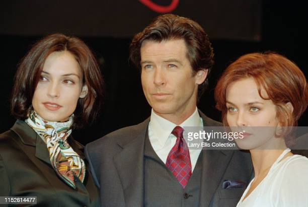 Irish actor Pierce Brosnan poses with his costars Famke Janssen and Izabella Scorupco during a photocall for the new James Bond film 'GoldenEye' UK...