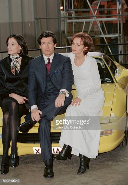 Irish actor Pierce Brosnan poses with his co-stars Famke Janssen and Izabella Scorupco during a publicity shoot for the James Bond film 'GoldenEye',...