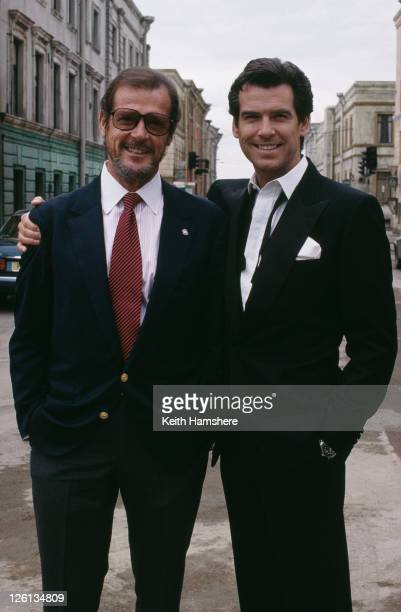 Irish actor Pierce Brosnan poses with Roger Moore a former incarnation of superspy James Bond on the set of the film 'GoldenEye' 1995