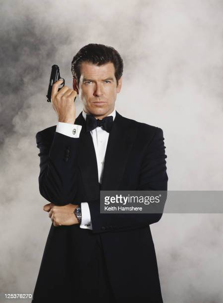 Irish actor Pierce Brosnan stars as 007 in the James Bond film 'Tomorrow Never Dies' 1997 . He is holding his trademark Walther PPK.