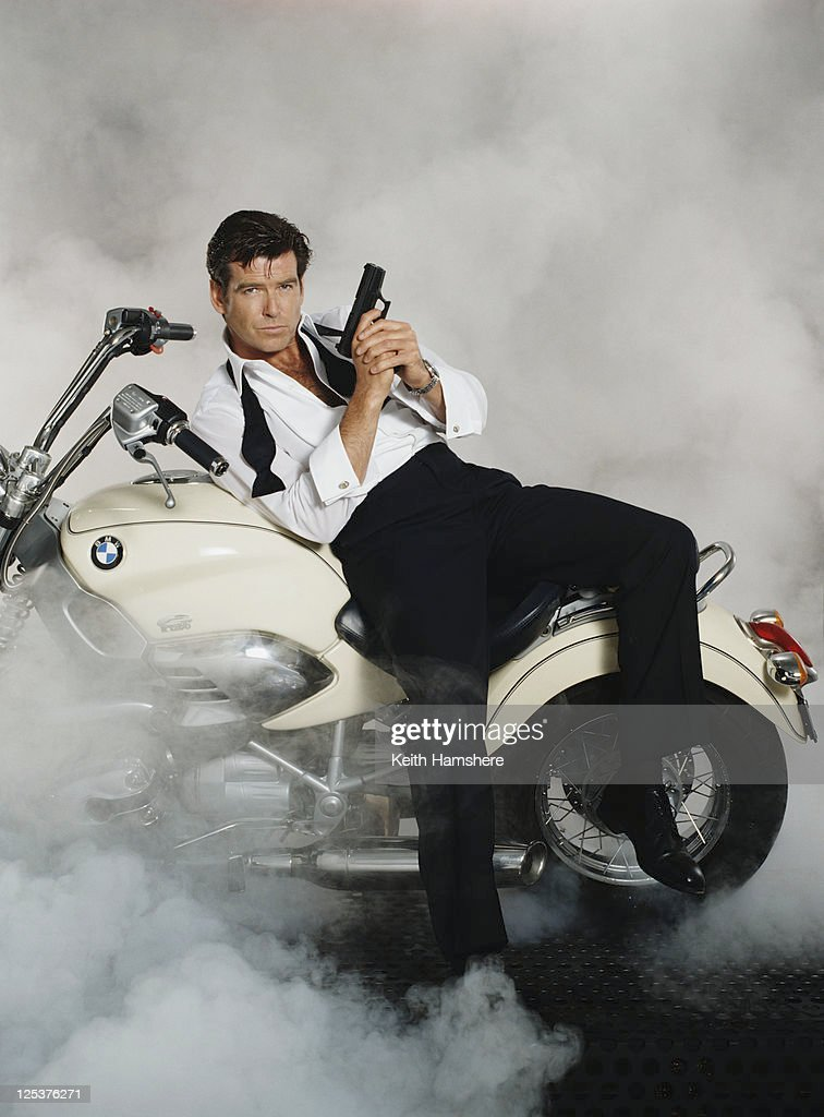 Irish actor Pierce Brosnan stars as 007 in the James Bond film 'Tomorrow Never Dies' 1997. He is sitting on a BMW R1200C in a publicity still for the film.