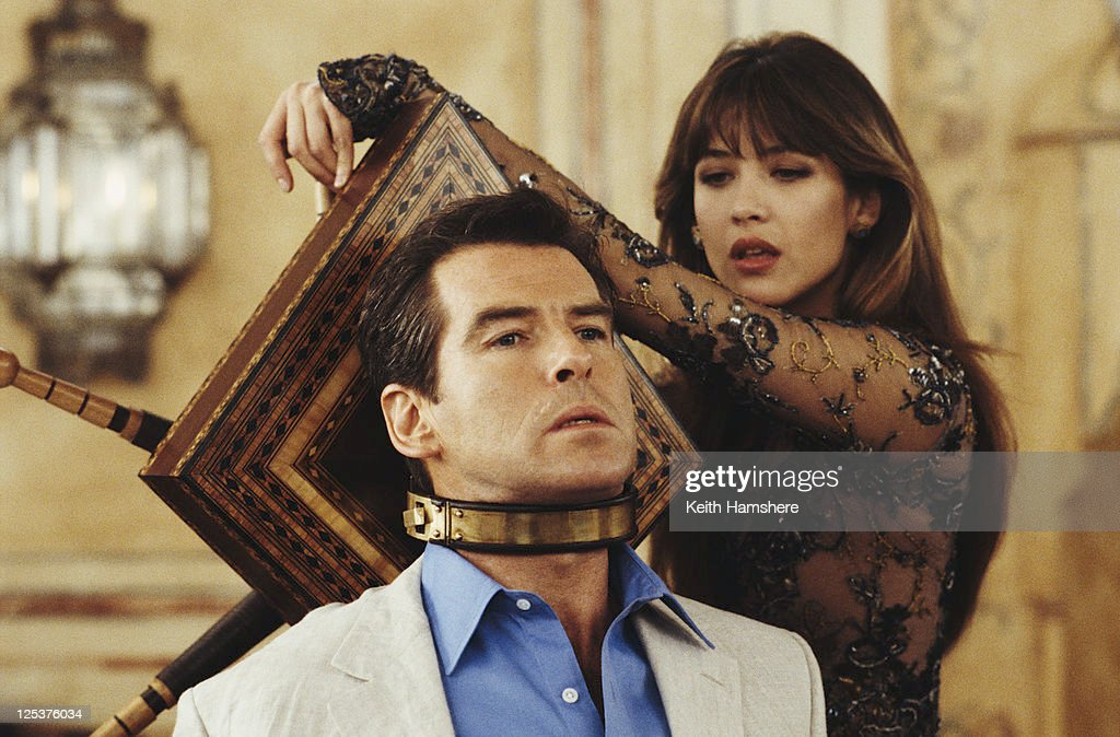 Irish actor Pierce Brosnan stars as 007 opposite French actress Sophie Marceau as Elektra King in the James Bond film 'The World Is Not Enough' 1999. In the scene, Elektra uses an antique device to torture the imprisoned Bond.