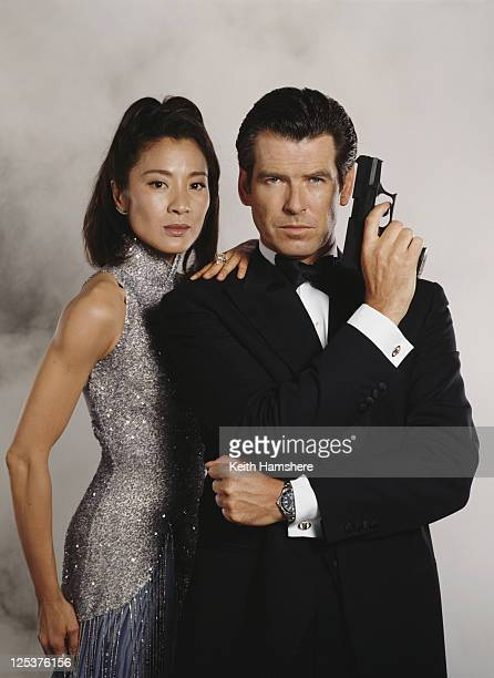 Irish actor Pierce Brosnan stars as 007 opposite Malaysian actress Michelle Yeoh in the James Bond film 'Tomorrow Never Dies' 1997 He is holding a...