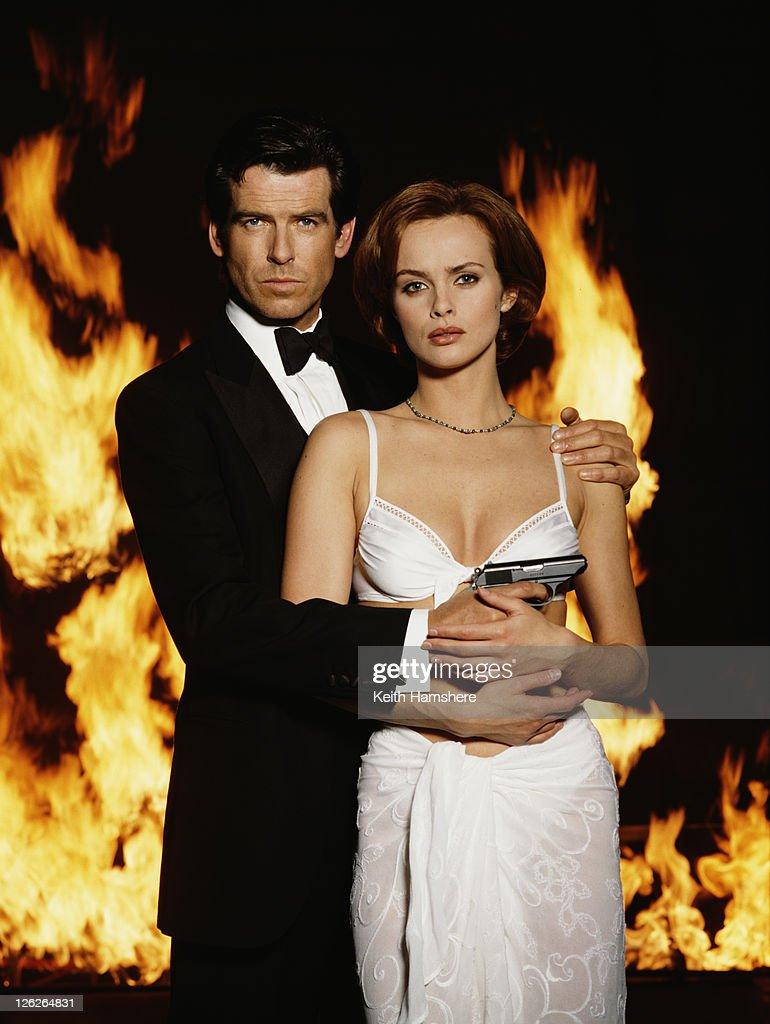 Irish actor Pierce Brosnan stars as James Bond opposite Polish actress Izabella Scorupco in the film 'GoldenEye', 1995. He is holding his iconic Walther PPK.
