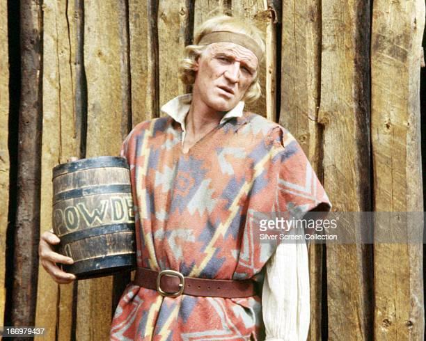 Irish actor Richard Harris as John Morgan holding a powder keg in 'The Return of a Man Called Horse' directed by Irvin Kershner 1976