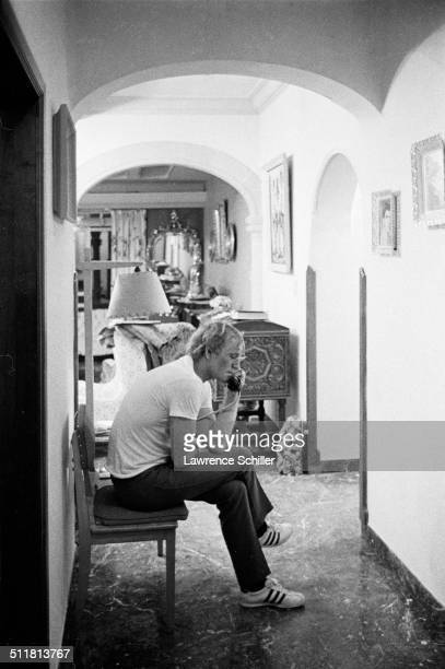 Irish actor Richard Harris talks on the telephone during a break in the filming of 'A Man Called Horse' Mexico 1968