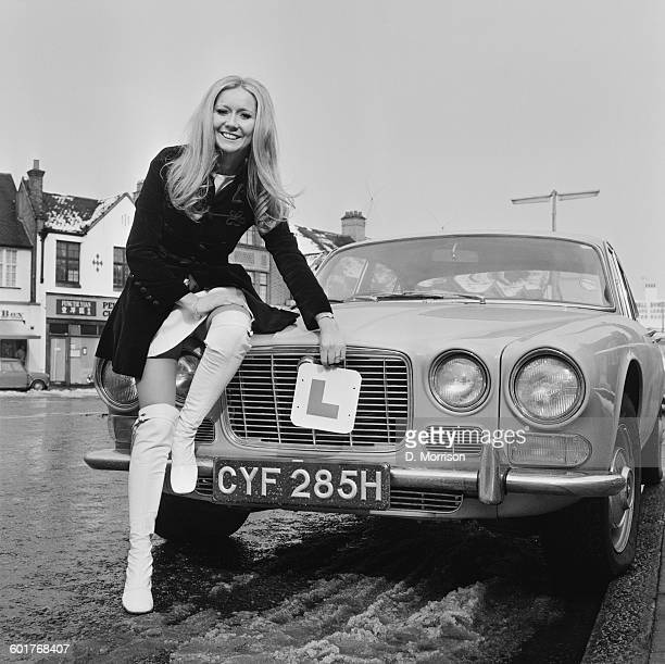 Irish actress and singer Clodagh Rodgers with the new Jaguar XJ6 that her husband and manager John Morris gave her for her birthday 5th March 1970