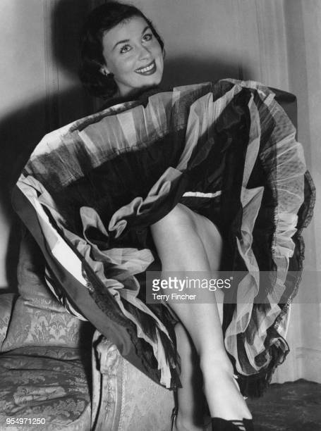 Irish actress Constance Smith wearing a taffeta petticoat at the May Fair Hotel in London 20th April 1954 She is in the UK to star in the film 'Tiger...