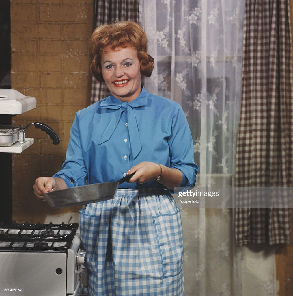 Irish actress Doreen Keogh pictured in character as Concepta Riley (previously Concepta Hewitt) holding a saucepan on the set of the television soap opera Coronation Street in Manchester in 1962.