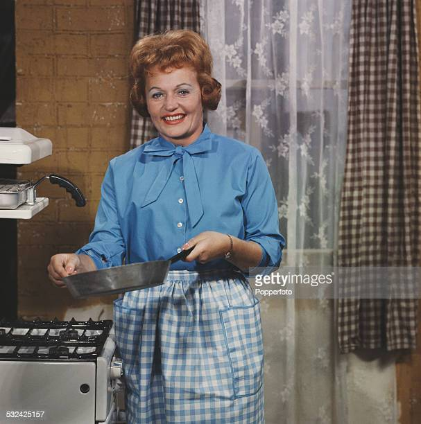 Irish actress Doreen Keogh pictured in character as Concepta Riley holding a saucepan on the set of the television soap opera Coronation Street in...