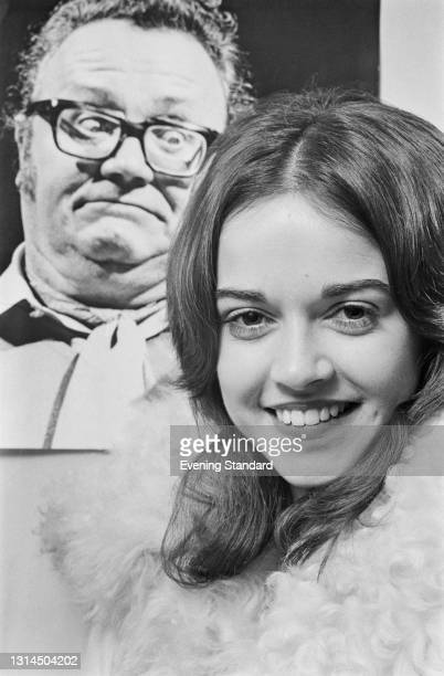 Irish actress Gemma Craven with a photograph of Welsh comedian and singer Harry Secombe behind her, UK, 18th December 1973. Craven had appeared as a...