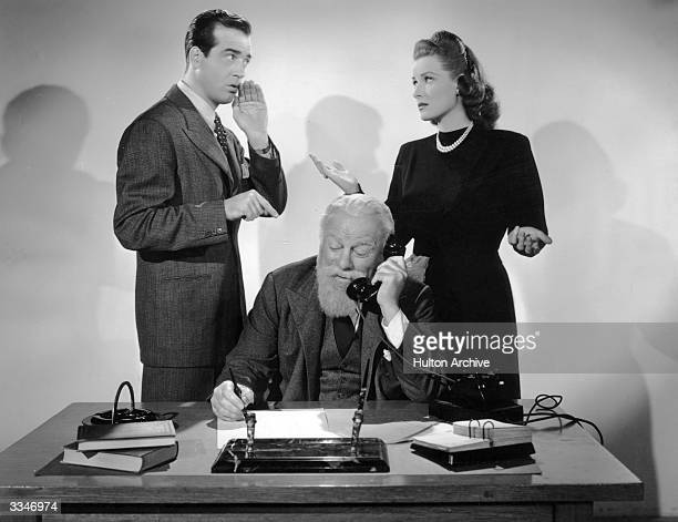 Irish actress Maureen O'Hara with American actor John Payne in a scene from 'Miracle on 34th Street' Edmund Gwenn plays the lovable Kris Kringle