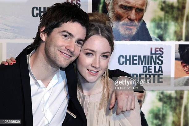 Irish actress Saoirse Ronan and British actor Jim Sturgess pose during the photocall of Australian film director Peter Weir's movie The Way Back on...