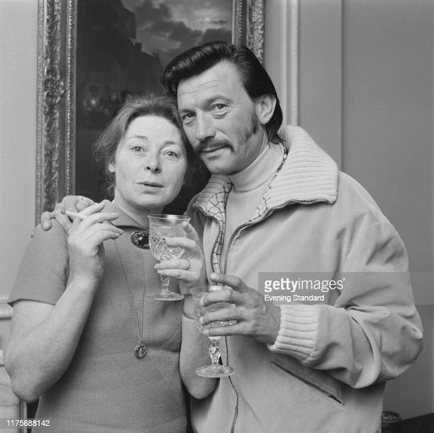 Irish actress Siobhan McKenna with British actor Laurence Harvey at a drinks party in London on 5th May 1970
