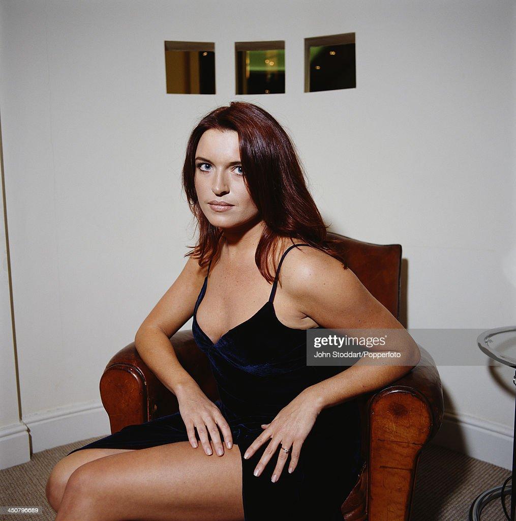 Irish actress Tina Hobley poses on an armchair, circa 1996.