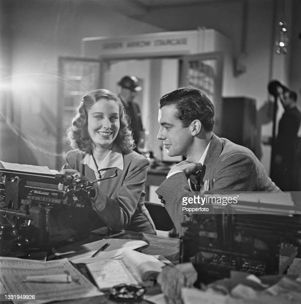 Irish actress Valerie Hobson , playing the role of fashion journalist Carol Bennett, and English actor Richard Greene , playing the role of war...