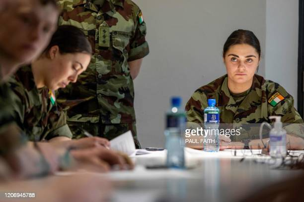 Irish Army cadets who are being trained to assist with the staffing of a call cente handling contact tracing for coronavirus patients are trained at...