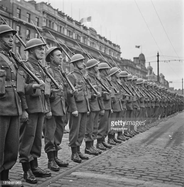 Irish Army troops line up for inspection by Taoiseach Eamon De Valera during an Easter Parade of Irish Free State Army Forces on O'Connell Street in...
