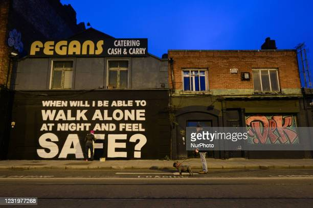 Irish artist Emmalene Blake working on her latest mural in Dublin's city centre during level 5 COVID-19 lockdown. The inscription 'When will I be...