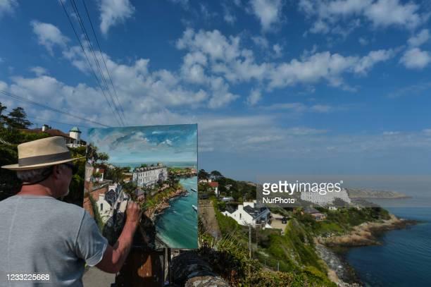 Irish artist Gerard Byrne paints near the Vico bathing place, in Dalkey. On Tuesday, 1 June 2021, in Dalkey, Dublin, Ireland.