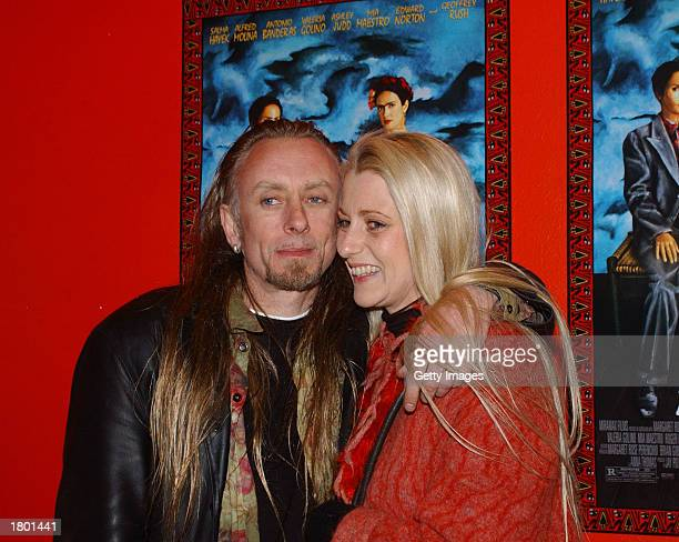 Irish artist Guggi and his wife attend the premiere of Frida at UGC February 17 2003 Dublin Ireland