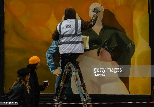 Irish artist Loughlin Brady Smith works in Dublin city center on a new mural for Zalandos spring marketing campaign 'Here to Stay'. The campaign aims...