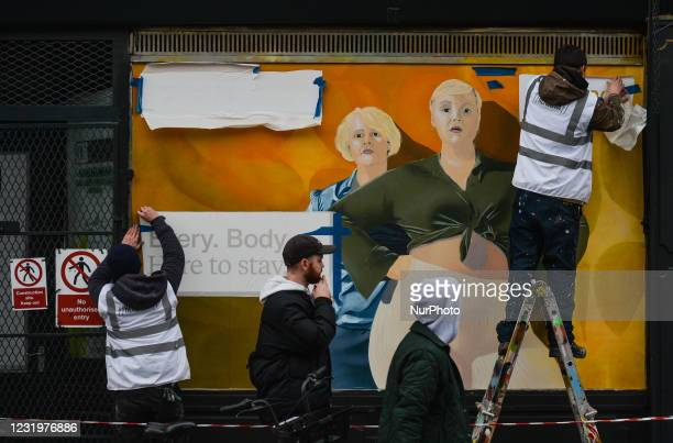 Irish artists Cormac Dillon and Loughlin Brady Smith work in Dublin city center on a new mural for Zalandos spring marketing campaign 'Here to Stay'....