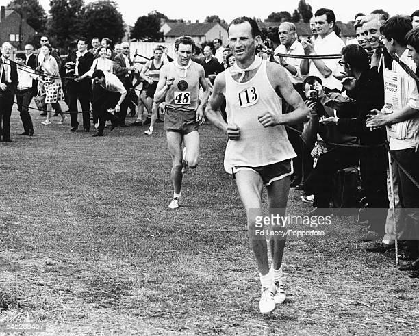 Irish athlete Jim Hogan leading his British counterpart Graham Taylor at the close of the Polytechnic Marathon at Chiswick Stadium London June 11th...