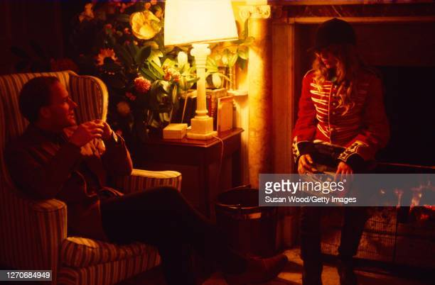 Irish author and conservationist Desmond Guinness sits in an armchair as he talks with his daughter Marina Guinness dressed in a jacket and leaning...