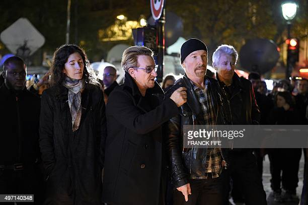 Irish band U2 lead singer Bono guitarist The Edge and bass player Adam Clayton pay homage to attacks' victims near the Bataclan concert hall on...