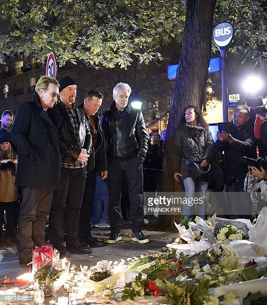Irish band U2 lead singer Bono guitarist The Edge drummer Larry Mullen Jr and bass player Adam Clayton pay homage to attacks victims near the...